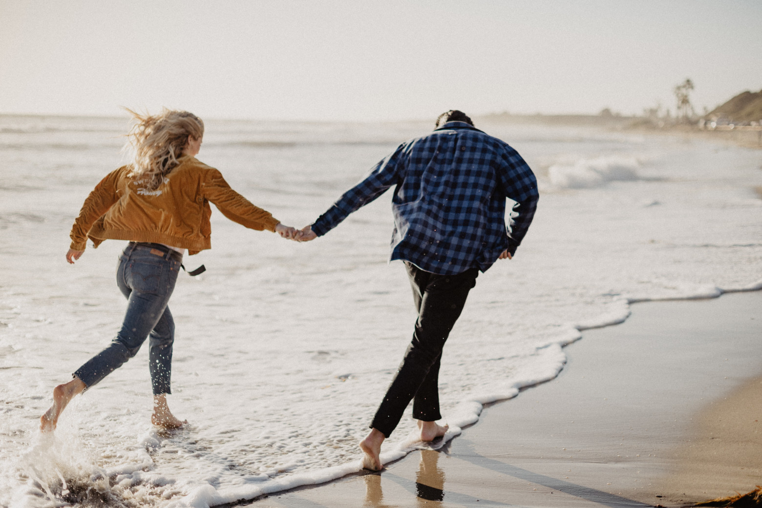 Couple running on the beach | Brocoff Photography